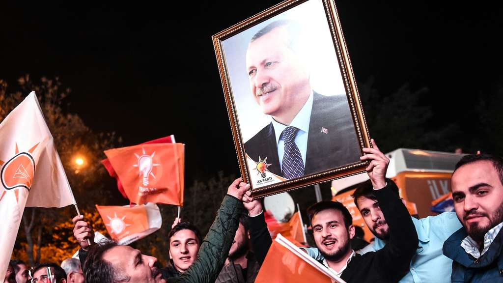 TOPSHOTSSupporters of Turkey&#39s Justice and Development Party (AKP) hold up a portrait of Turkish President Recep Tayyip Erdogan as they celebrate in Istanbul after the first results in the country&#39s general election on November 1, 2015. Turkey&#39s long-dominant Justice and Development Party (AKP) scored a stunning electoral comeback, regaining its parliamentary majority in a poll seen as crucial for the future of the troubled country. AFP PHOTO / OZAN KOSE