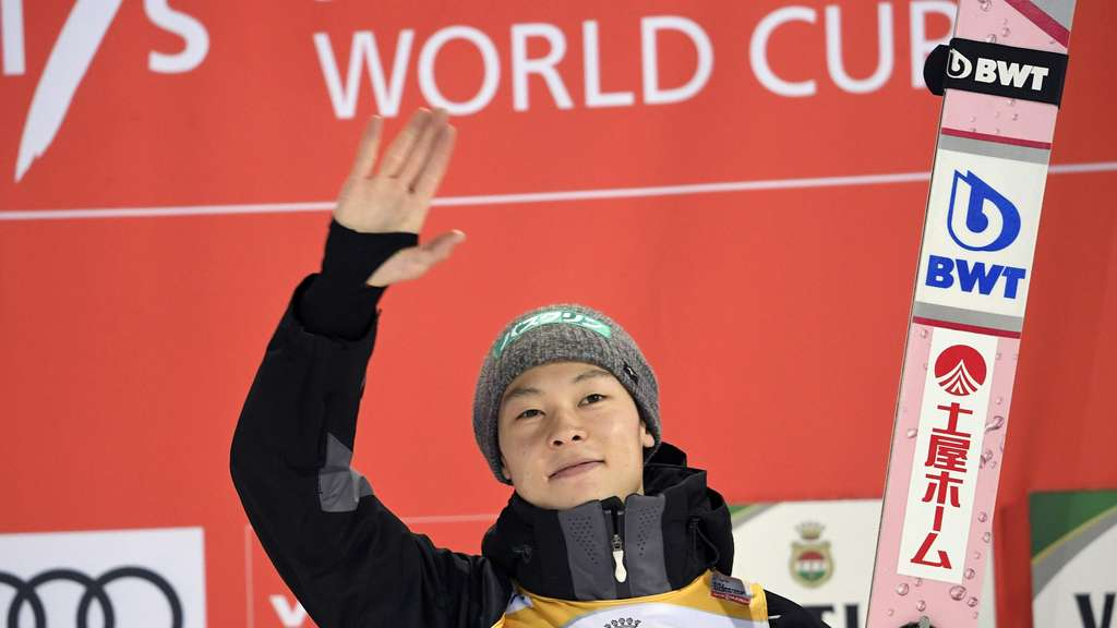 Ryoyu Kobayashi of Japan celebrates on the podium after the men's Large Hill Ski Jumping event at the FIS World Cup Lahti Ski Games in Lahti, Finland, on February 10, 2019. (Photo by Markku Ulander / Lehtikuva / AFP) / Finland OUT